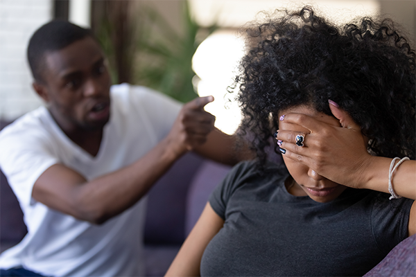 African American couple arguing on couch - Five Warning Signs of a Manipulative Personality