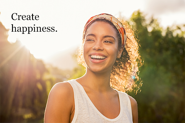 Happiness is something you create - woman smiling on a sunny day.