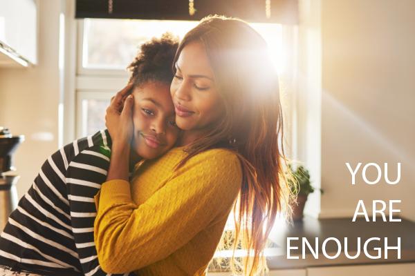 Overcome mental health stigma. Mother hugging her daughter, smiling.